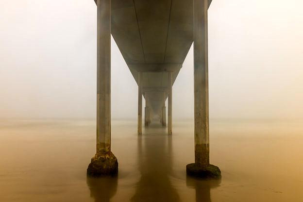 Fog Under The Ocean Beach Pier