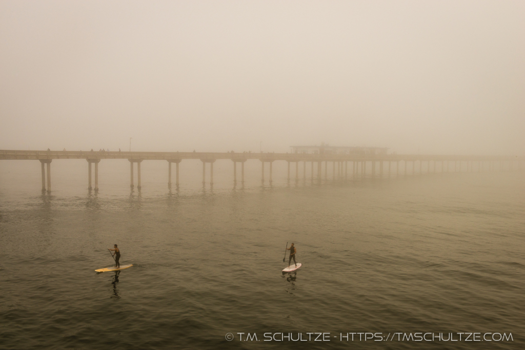 Paddling By The Pier